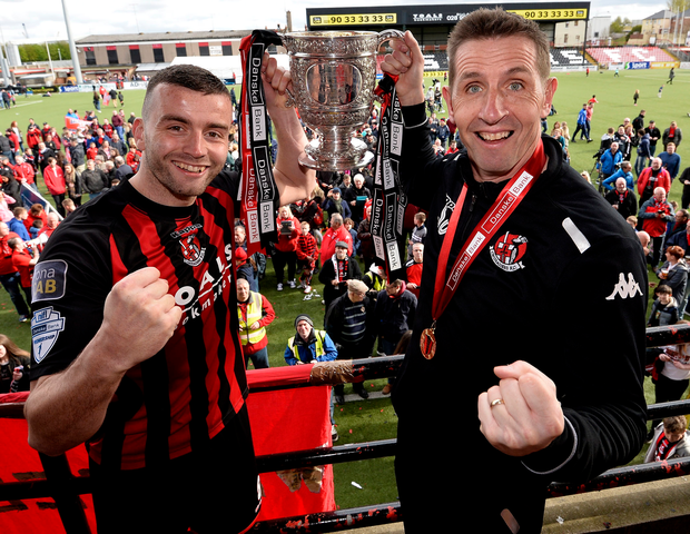 Winners: Crusaders manager Stephen Baxter (right) and skipper Colin Coates celebrate title win