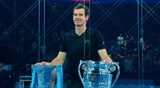 Double success: Andy Murray with World Tour Finals trophy and prize for number one ranking