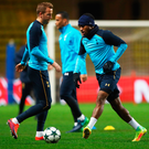 Warm up: Tottenham's Harry Kane and Danny Rose train last night ahead of their match against Monaco tonight