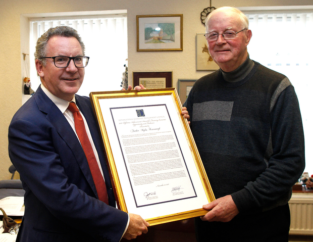 Fr Myles Kavanagh (right) is presented with a lifetime achievement award for his economic development efforts by Mark O'Connell