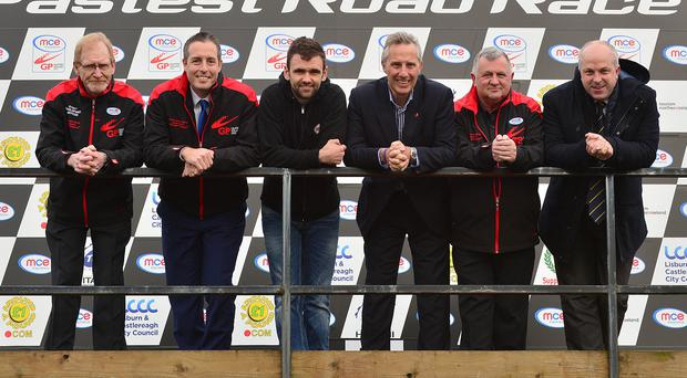 Front row of the grid: (from left) Ken Stewart of the Dundrod club, Minister for Communities Paul Givan MLA, road racing star William Dunlop, Ian Paisley MP, Eddie Johnston of the Dundrod club and Alderman James Tinsley, of Lisburn & Castlereagh City Council, at the Dundrod circuit