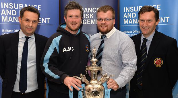 Up for the cup: CSN captain Andrew Cowden (second left) with Carrick secretary Glen Graham. The draw was made by Shane Matthews, of sponsors Arthur J. Gallagher (left) and the president of the NCU, Peter McMorran