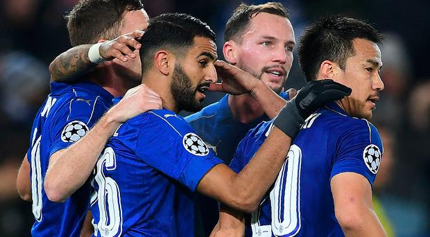 Leicester City's Algerian midfielder Riyad Mahrez (2L) celebrates scoring his team's second goal from the penalty spot. AFP/Getty Images