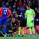 Deja vu: Vincent Kompany's face says it all as he leaves City's victory over Crystal Palace early with a knee ligament injury