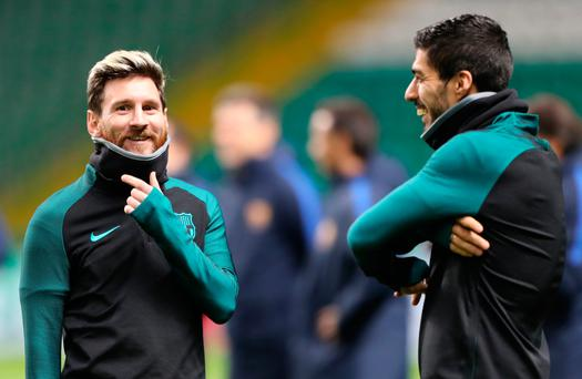 Wrap up warm: Lionel Messi (left) and Luis Suarez at Barcelona's training session at Celtic Park last night