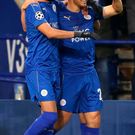 Blue heaven: Leicester scorers Shinji Okazaki and Riyad Mahrez celebrate historic win