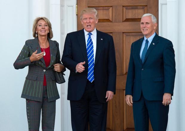 President-elect Donald Trump and Vice President-elect Mike Pence as they meet with businesswoman Betsy DeVos at Trump National Golf Club in Bedminster, New Jersey.(File photo by AFP/Getty Images)