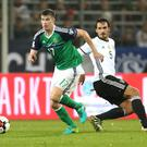 Key figure: Paddy McNair takes on Germany in the World Cup qualifier in Hannover