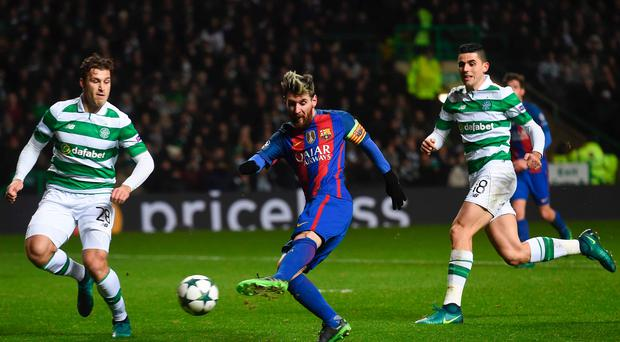 Double trouble: Lionel Messi scores the first of his two goals last night against Celtic