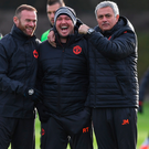 All smiles: Wayne Rooney and Jose Mourinho joke with sports therapist Rod Thornley (centre)