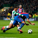 Spot of bother: Celtic's Emilio Izaguirre brings down Barca star Luis Suarez to concede a penalty at Parkhead