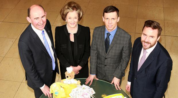 BOOST: Mark Walker of Hilton NI, Dame Maureen Thomas, Sunday Life editor Martin Breen and Simon Sheehan of the Hilton Foundation at the announcement of the charity giveaway.