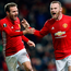 Goal happy: Wayne Rooney celebrates his European record strike with Juan Mata