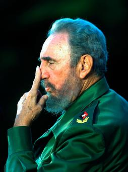 (FILES) This file photo taken on December 07, 2005 shows Cuban President Fidel Castro gesturing as he delivers his speech during a political meeting in Cardenas city, province of Matanzas, some 80 miles east of Havana. Cuban revolutionary icon Fidel Castro died late on November 25, 2016 in Havana, his brother, President Raul Castro, announced on national television. AFP/Getty Images
