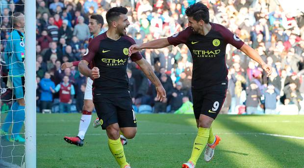 Manchester City's Sergio Aguero (left) celebrates with team-mate Nolito after scoring his side's second goal during the Premier League match at Turf Moor, Burnley. PA