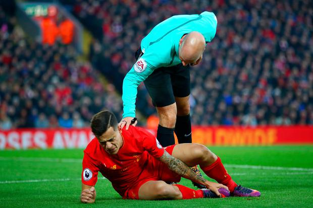 Referee Anthony Taylor talks to Philippe Coutinho of Liverpool during the Premier League match between Liverpool and Sunderland at Anfield on November 26, 2016 in Liverpool, England. (Photo by Clive Brunskill/Getty Images)