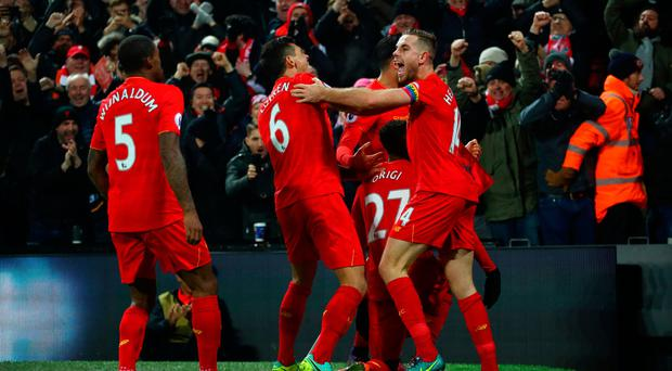 Divock Origi (2nd R) of Liverpool celebrates scoring the opening goal with his team mates during the Premier League match between Liverpool and Sunderland at Anfield on November 26, 2016 in Liverpool, England. (Photo by Clive Brunskill/Getty Images)