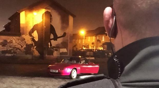 Officers were attacked by missiles after stopping a stolen car in the Divis area of West Belfast. Picture from PSNI