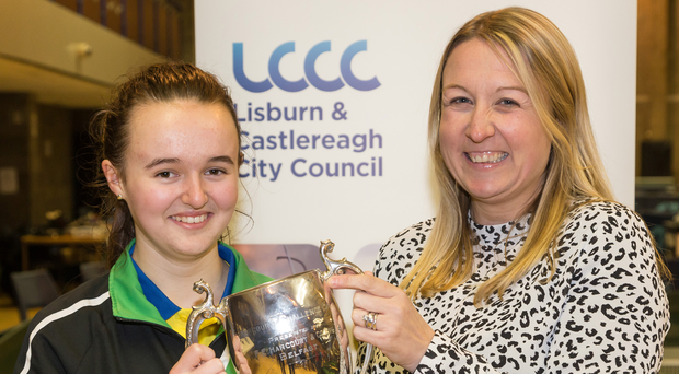 Winner: Rebecca Finn receives the Ulster Open Women's trophy from Cathryn Gibson (Douglas Huston)
