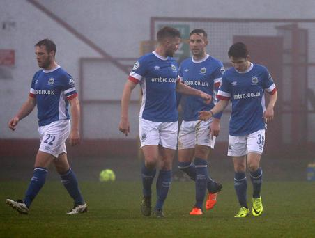 Big impact: Paul Smyth (38) is congratulated after putting the Blues 2-0 up at a foggy Shamrock Park