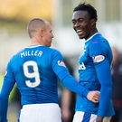 Double act: Kenny Miller and Joe Dodoo celebrate linking up for Rangers' two goals