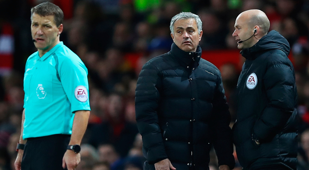 Angry man: Jose Mourinho speaks with fourth official Anthony Taylor before United's manager is sent to the stands