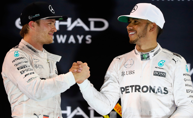 Well done: Lewis Hamilton congratulates new World champion Nico Rosberg