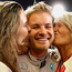 Sealed with a kiss: Nico Rosberg is congratulated by his wife Vivian Sibold and mother Sina Rosberg
