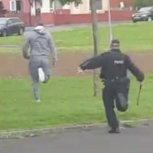 UDA man Dee Coleman runs from the police in the Shankill estate before being arrested.