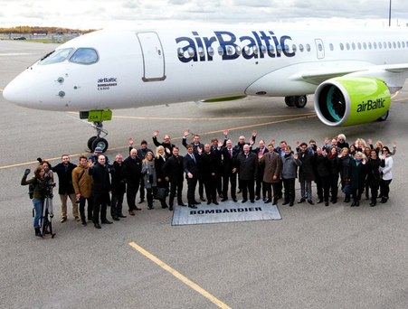 The Air Baltic team with the new CS300 jet