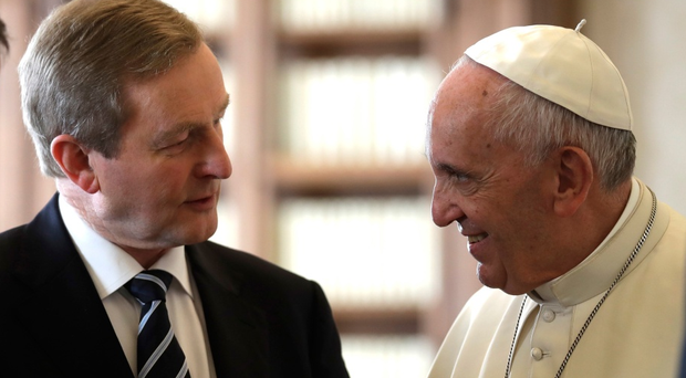 Pope Francis exchanges gifts with Irish Taoiseach Enda Kenny during a private audience in his private studio at the Vatican, Monday, Nov. 28, 2016.