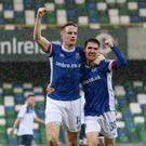 Cheers: Aaron Burns and Paul Smyth celebrate a Linfield goal against Ards earlier in the season