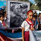 Children pay their last respects to Cuban revolutionary icon Fidel Castro in Bayamo, Granma province, on November 28, 2016. AFP/Getty Images