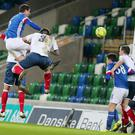 On target: Mark Haughey scores Linfield's fifth