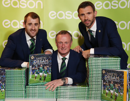 Brought to book: Niall McGinn, Michael O'Neill and Gareth McAuley launch the Dare to Dream book at Eason in Belfast last night