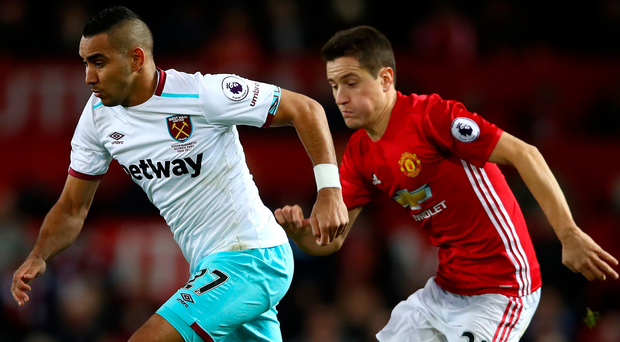 We'll meet again: Dmitri Payet and Ander Herrera (right) battle it out in the 1-1 draw on Sunday at Old Trafford
