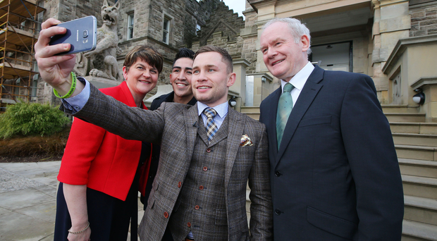 Carl Frampton poses for a selfie with First Minister Arlene Foster, opponent Leo Santa Cruz and Deputy First Minister Martin McGuinness at Stormont yesterday