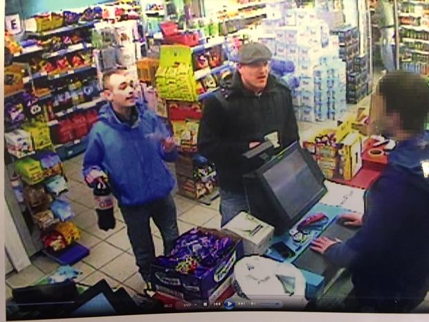 Louis Maguire, wearing a blue jacket, and Christopher Power buying mixers after they had been in Belfast city centre with Eamonn and were returning to Maguire's house for drinks. Eamonn was waiting outside.
