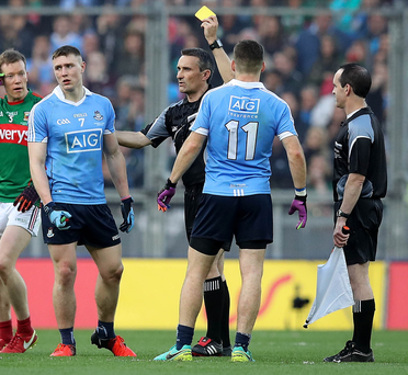 Admission: Maurice Deegan shows 'only' a yellow card to John Small