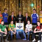 Big draw: Terry McCrudden, Head of Business at Bank of Ireland, Ulster President Michael Hasson and Ciaran McCavana with some of the players at yesterday's Bank of Ireland Dr McKenna Cup 2017 launch at the Fitzwilliam Hotel in Belfast