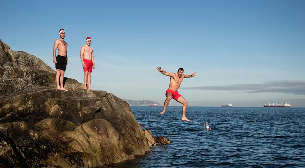 Leap of faith: Ireland and Ulster player Tommy Bowe was pictured at the 40-foot jump in Dun Laoghaire yesterday to launch the 2016 Coca-Cola Designated Driver