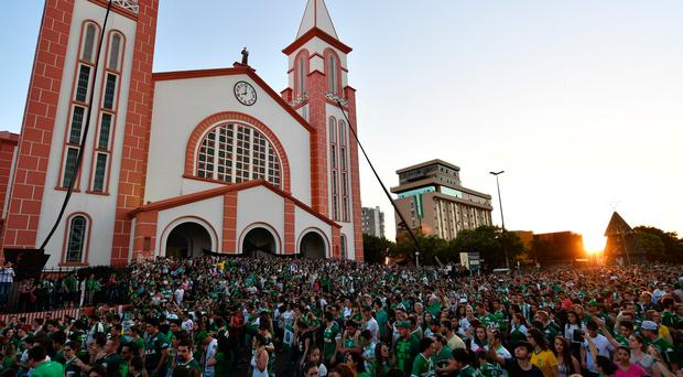 Congregation: people surround a church during a mass in memoriam of the players of Brazilian team Chapecoense Real killed in Chapeco.