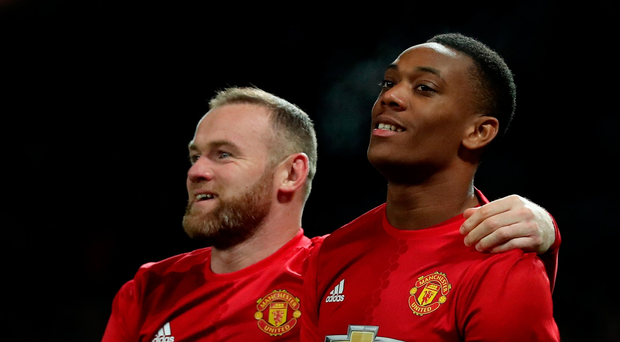 Manchester United's Anthony Martial (right) celebrates scoring his side's second goal of the game with team-mate Wayne Rooney (left) during the EFL Cup, Quarter Final match at Old Trafford, Manchester. PA
