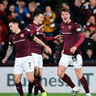 On target: Heart of Midlothian's Robbie Muirhead (right) celebrates scoring his side's first goal against Rangers at Tynecastle