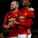 Take that: United ace Anthony Martial celebrates his first goal with Wayne Rooney