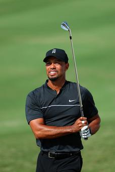 Indifferent: Tiger Woods fired four birdies in the opening eight holes but finished one-over-par