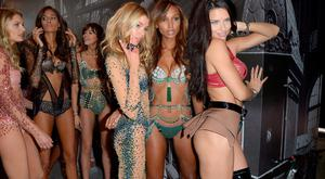 Stella Maxwell, Jasmine Tookes and Adriana Lima pose backstage during the Victoria's Secret Fashion Show on November 30, 2016 in Paris, France. (Photo by Dominique Charriau/Getty Images for Victoria's Secret)