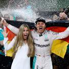 Dream come true: Nico Rosberg celebrates winning the Formula One championship with his wife, Vivian