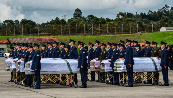 The remains of the members of the Brazilian football team Chapecoense Real who died in a plane crash in the Colombian mountains are readied for the flight home