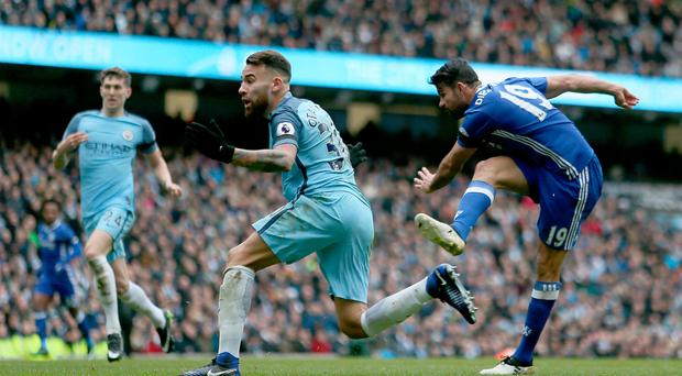 Chelsea's Diego Costa scores his sides first goal of the game during the Premier League match at the Etihad Stadium, Manchester. Pic Richard Sellers/PA Wire